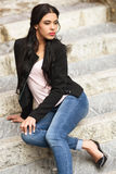 Hispanic young woman wearing casual clothes in urban background Stock Images