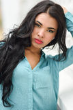 Hispanic young woman wearing casual clothes in urban background Royalty Free Stock Photos