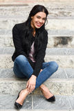 Hispanic young woman wearing casual clothes in urban background Stock Photos