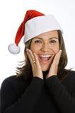 Hispanische Frau, die einen Weihnachtshut trägt Stockbild