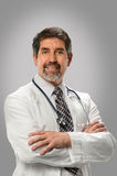 Hispanischer Doktor Smiling Lizenzfreie Stockbilder
