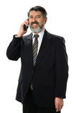 Hispanischer Geschäftsmann Using Phone Stockfotografie