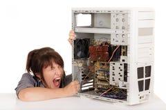 Histeria del ordenador de la mujer foto de archivo