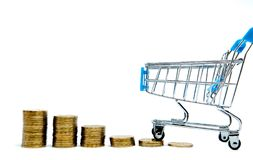 Histogram of coins and shopping cart or supermarket trolley on a white background, business finance shopping concept stock photography
