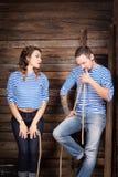 Histoire d'amour de couples de marins sur le fond en bois rapport Images stock