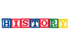 Historia - alfabetet behandla som ett barn kvarter på vit royaltyfri bild