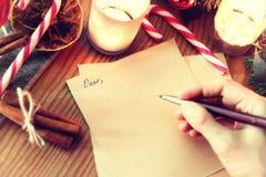 Historia de la escritura de la mano de la Navidad Fotos de archivo