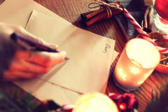 Historia de la escritura de la mano de la Navidad Foto de archivo