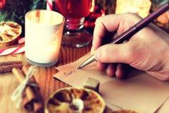 Historia de la escritura de la mano de la Navidad Fotografía de archivo libre de regalías