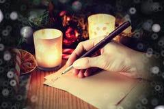 Historia de la escritura de la mano de la Navidad Fotografía de archivo