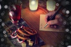 Historia de la escritura de la mano de la Navidad Imagenes de archivo