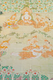 Historia del budismo pintada en la pared esmaltada de la teja Imagen de archivo