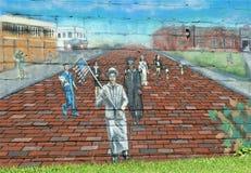 Historia negra Muriel en el lado de un edificio imágenes de archivo libres de regalías