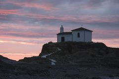Historic. Hermitage catholic on the coast , Atlantic Ocean, Spain Royalty Free Stock Photo