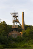 Historic abandoned Landek coal mine tower surrounded by trees Royalty Free Stock Image