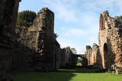 Historic abbey ruins with sunlight and shadows. Historic Cistercian abbey ruins in England UK Royalty Free Stock Photos