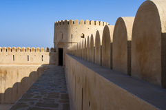 Historic adobe fortification. Watchtower of Sunaysilah Castle or Fort in Sur, Al Sharqiya Region. Sultanate of Oman, Middle East royalty free stock images