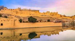 Amer Fort panoramic view with adjacent Maota lake at sunrise at Jaipur, Rajasthan, India