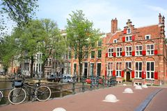 Historic downtown of Amsterdam, the Netherlands, traditional architecture stock photos