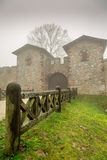 Historic Ancient Castle in a Foggy Misty Day and Wooden Fence. Photo royalty free stock photos