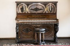 Historic ancient piano. Inside Vlad the Impaler Castle royalty free stock images