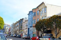 Historic apartments and buildings in San Francisco. Historic homes and colorful apartments on a hill in San Francisco, California Royalty Free Stock Photos