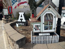 Historic Apex, North Carolina. Town sign on North Salem Street in Historic Apex, North Carolina (NC) with a mural in the background. The Little Free Library stock photography