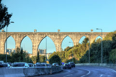 Historic aqueduct in the city of Lisbon built in 18th century Royalty Free Stock Photo