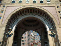 Historic Arch with buildings. Historic Grand  Arch with buildings iin background Royalty Free Stock Images