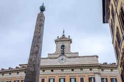 The historic architectural building with windows with a bell tower and a cross on the roof at the administrative building in Rome, Royalty Free Stock Photos