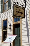 Large sign outside historic landmark, Starr Clark Tin Shop, Mexico, New York, 2016. Historic architecture of business also used as part of abolitionist movement Royalty Free Stock Photography