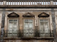 Historic Architecture In Tavira Portugal. With second floor apartments with balconies with wrought iron railings royalty free stock photos