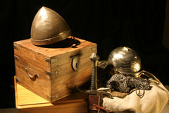 Historic artefacts. Helmets and sword Royalty Free Stock Image