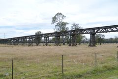 Historic Australian rail bridge. The rail bridge at Gundagai over the Murrumbidgee river and floodplain is a spectacular latticework of wooden trusses in Stock Image