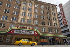 The historic Aztec theater in San Antonio Texas. January 8, 2016 San Antonio: a yellow taxi in front of the historic Aztec theater in the downtown area Stock Photo