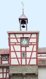 Historic bakehouse in Forchtenberg. Detail of a historic bakehouse with turret clock in Forchtenberg, a small town in Hohenlohe located in Southern Germany Royalty Free Stock Image
