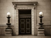 Historic Bank Building. Historic financial institution in sepia Stock Image