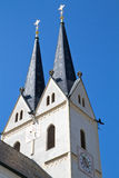 Historic Bavarian church steeple. Against blue sky Stock Photos