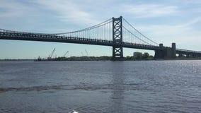Historic Ben Franklin Bridge over the Delaware River. Beautiful view of the historic Ben Franklin Bridge over the Delaware River stock footage