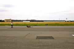 Historic Berlin Tempelhof Airport. Skateboarding on the former Runway Stock Photo