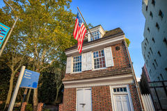 The historic Betsy Ross house. PHILADELPHIA - OCT 19: The historic Betsy Ross house tourism landmark with hanging American flag in Old City Philadelphia on royalty free stock image