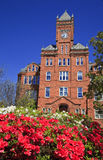 Historic Biddle Hall at Johnson C. Smith. Biddle Memorial Hall at Johnson C. Smith University in Charlotte, NC with azaleas in bloom stock image