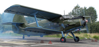 Historic biplane rolling out. An-2 Antonov gives full throttle Royalty Free Stock Photo
