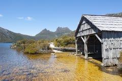 Historic boat shed Cradle Mountain Tasmania Australia. Beautiful landscape scenery of Cradle Mountain National Park in Tasmania, Australia, with Dove Lake and royalty free stock photos