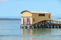Historic boat shed at the end of a pier at the beach Royalty Free Stock Photo