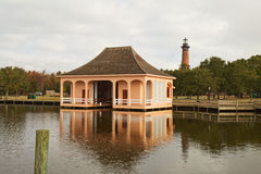 Historic boathouse and Currituck Beach Lighthouse near Corolla, Royalty Free Stock Photos