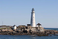 Historic Boston Harbor Lighthouse on a Summer Day. Tours are provided to historic Boston Harbor lighthouse on Little Brewster Island during the summer months Stock Photo