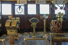 Historic brass instruments and ships wheel stock images