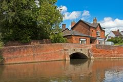 Historic brick bridge over river. Very old bridge built with bricks over stream in England Stock Photo