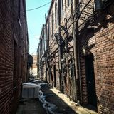 Historic brick building alleyway Stock Image